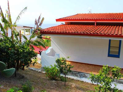 Photo for Semi-detached villa with garden, veranda with sea view, only 400 m from the sea.