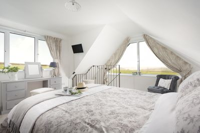 Double en-suite Bedroom with kingsize bed and views across to the Camel estuary