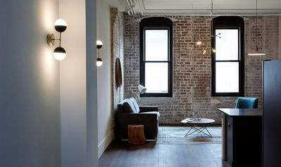 Follow the industrial lighting to your urban suite.