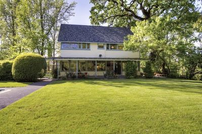 """Elegant Calistoga home with expansive lawns.  If you see a """">""""  , that's a video"""