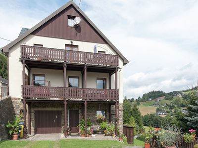 Photo for Holiday home in an idyllic setting in the heart of the Erzgebirge mountains with private balcony