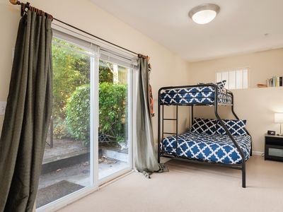 Photo for Out of Africa: 3 en-suite bedrooms, yard with BBQ