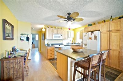 Spacious, clean kitchen with dishwasher, island seating and writing desk too!