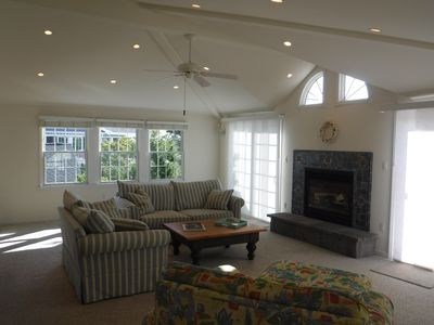 Living Room with Views to Front Deck. Large Flat screen is other corner