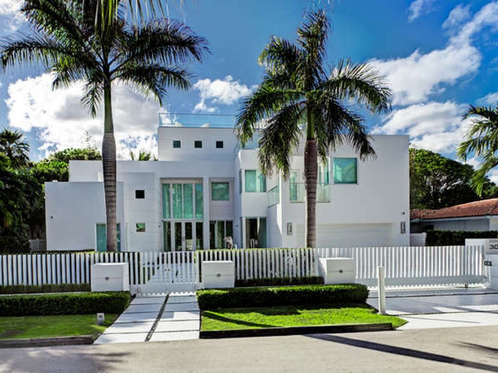 Modern Mansion AT The Beach ON Cover of HomeAway Downtown