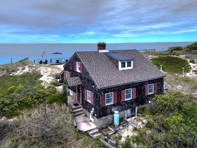 Photo for Beachfront cottage w/ deck & hammock on the dunes, sunset ocean views!