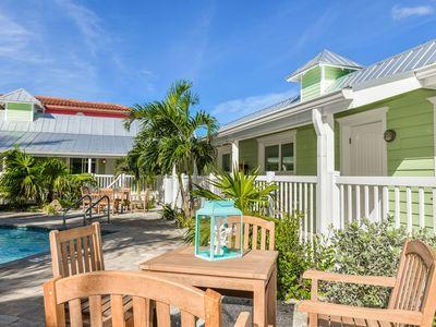 Photo for Tropical Breeze Resort - Large Unit. Sleeps 4. Pool View. 1/2 Block to Siesta Key Beach and Village District. INCLUDED: Daily Housekeeping, Bikes, 2 Pools/1 Spa, Beach Chairs, Beach Towels, WiFi, Parking , Games, BBQs and More!