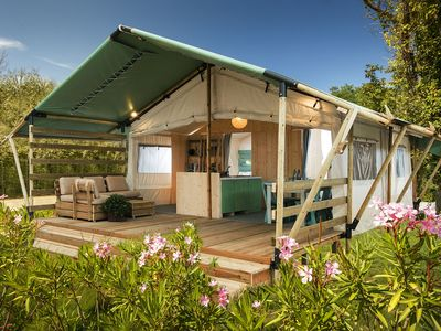 Photo for Luxury glamping tent with bathroom/kitchen, located in a park with swimming pool