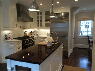 New 2015 eat-in kitchen with professional appliances, wood and stone countertops
