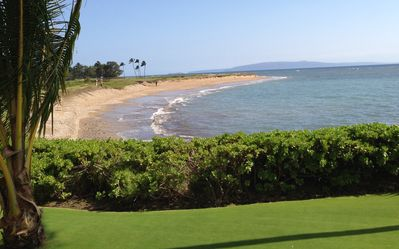 This view of the beach with an island in the background, is steps from our condo