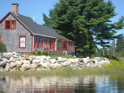 The deck and back of the cottage from the water.