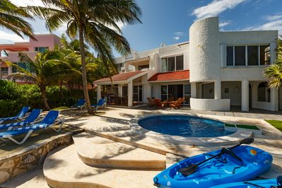 Ocean front pool, terraces with lounge chairs, grill and dining area.