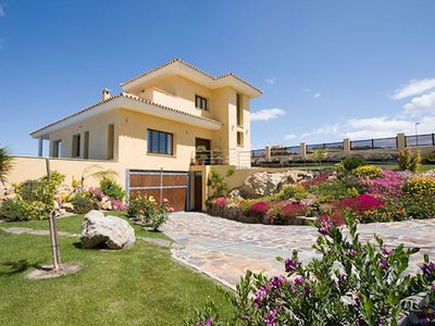 Photo for A luxury 2-bedroom villa on the 9th fairway of a world class golf course.