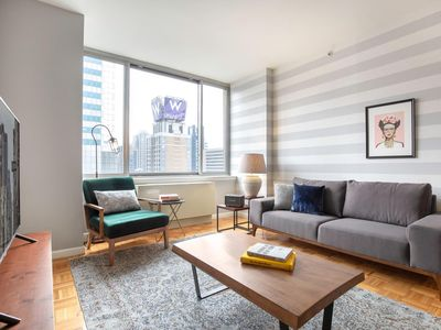 Photo for Rad Midtown West 2BR w/ roomy sundeck, gym, near Times Sq by Blueground