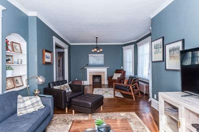 Main floor living room with hardwood floors and lots of charm