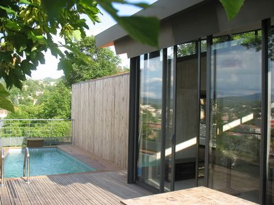 Photo for Modern wooden house with private pool in the heart of the Luberon