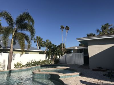 Enjoy the privacy of our large backyard looking at the unique twin palms.