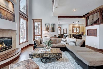The open living room, dining, and kitchen are perfect for entertaining the group