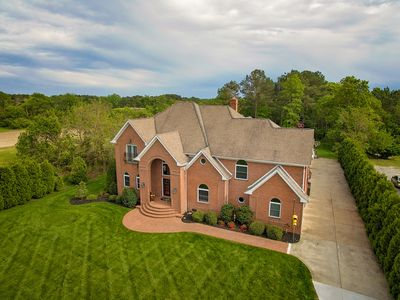 Photo for Expansive estate with a pool, hot tub, basketball court, wet bar, & more!