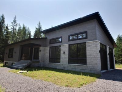 Photo for Great new contemporary house in the wood, 3 minutes from the lake St-Joseph