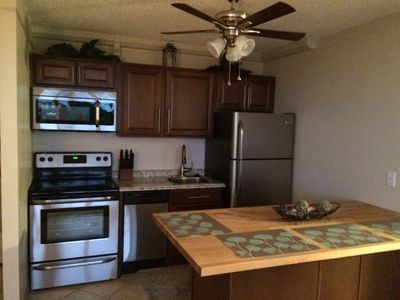 Photo for Beautiful updated 4th floor condo, heated pool, free wifi & on the Beach!