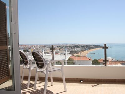 Photo for Fabulous townhouse - stunning sea views, large terraces, air con and wifi