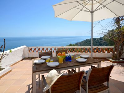 Photo for Attractive terraced house with sea views, in atranquil  community,1.5kmfrom the beacha