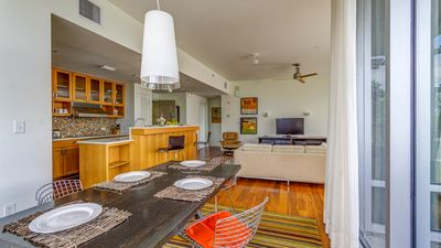 Open floor plan with living, dining, and kitchen