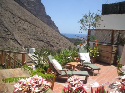 Photo for Stunning island location with terrace enjoying views of the mountains and ocean
