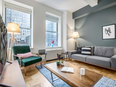 Photo for Spunky Wall Street 1BR w/Speakeasy, Doorman + Gym by Blueground