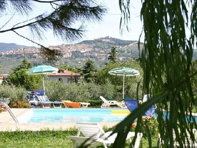 Photo for Attractive apartment in 19 century stone farmhouse, Tuscany, shared pool, garden