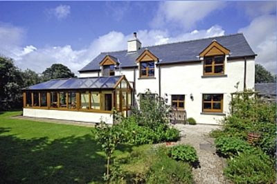 Photo for Beautiful 400 year old Welsh Cottage. Family friendly. Sleeps 8. Private gardens