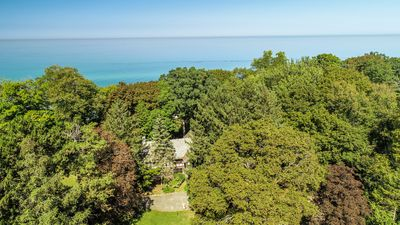 Photo for (Two July Weeks Available) Secluded Lakefront Estate with 200 ft of Private Beach and Tennis Court!