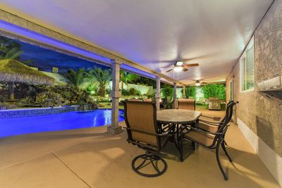 Large covered patio w/ceiling fans, dining & lounging areas,  natural gas grill.