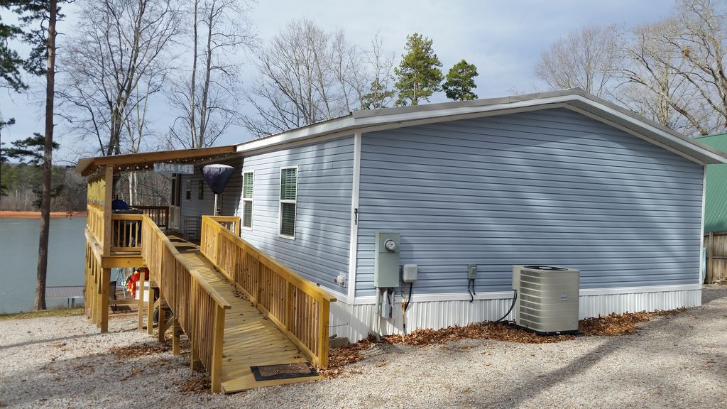 Spectacular view of kerr lake with floating dock and golf course half on mobile shipyard, mobile hot tub, mobile swimming pool, mobile restrooms, mobile river, mobile bridge, mobile storage shed, mobile floating deck, mobile island,