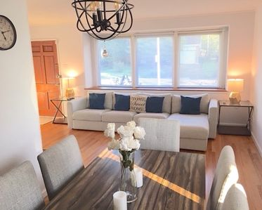 """Spacious Living Room with a comfortable couch and 55"""" Smart TV"""