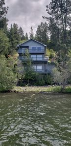 Photo for Large 3 level home with A/C, private dock & 100ft of water frontage on Lake CDA