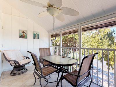 Photo for NEW LISTING! Lovely Siesta Key condo w/patio, shared pool & bay view -near beach