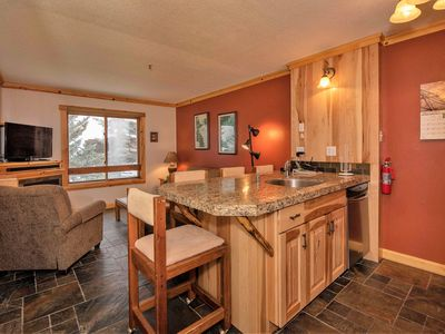 Photo for Slope access, shuttle service, wifi, hot tubs, dining/bar on site.