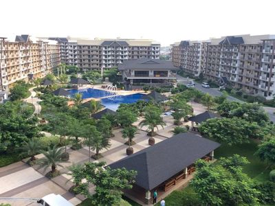 Photo for 2BR Resort Condo Near the Airport & Entertainment City