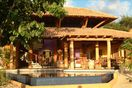 Poolside view of the Casa. Open-air luxury villa.