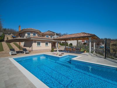 Photo for This 4-bedroom villa for up to 8 guests is located in Kastav and has a private swimming pool, air-co