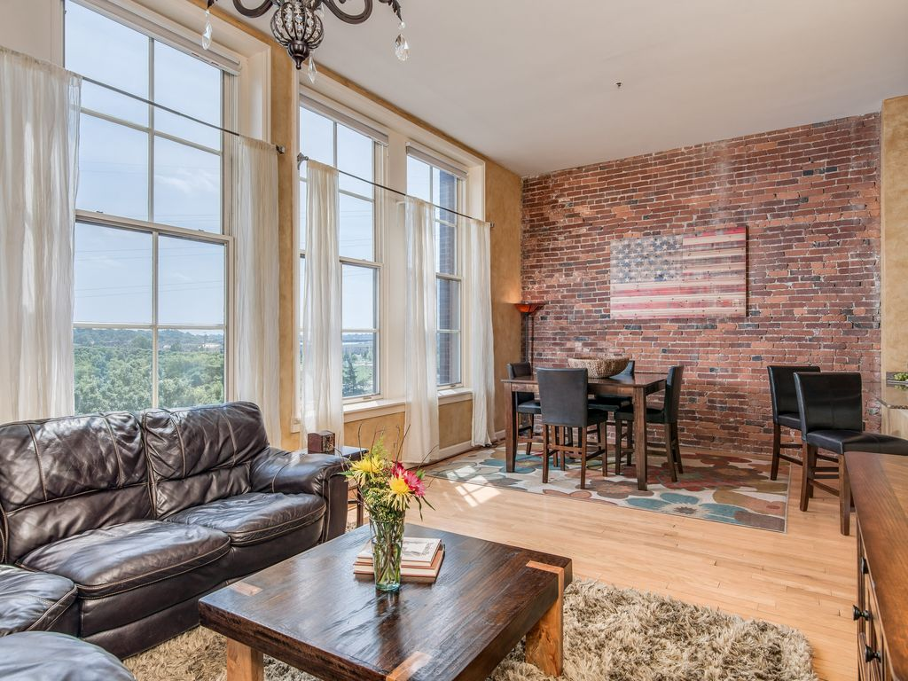 Beautiful Downtown Condo Overlooking River View Living And Dining Room