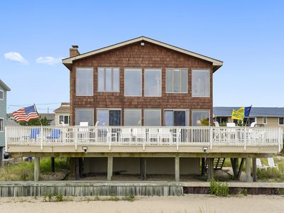 FREE DAILY ACTIVITIES!  Escape the hustle and bustle to this amazing beach front vacation home perfect for families of all ages!