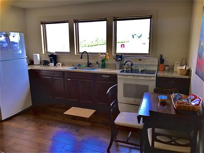 Full kitchen with stove, oven, fridge, microwave, and coffee maker