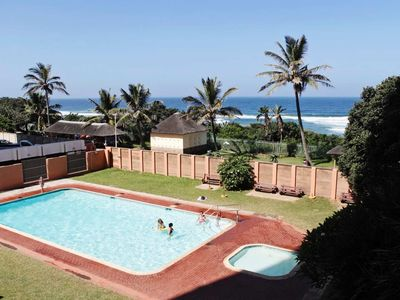 Photo for A breath-taking 180 degree beach view right from your bed or lounge.