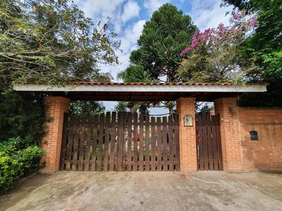 Photo for Beautiful wooden house with extensive green area.