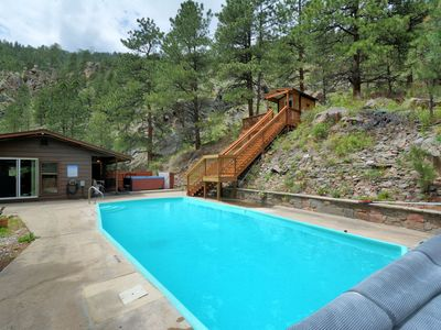Photo for Private cabin on river heated pool, huge hot tub, sauna, hiking, fireplace &more