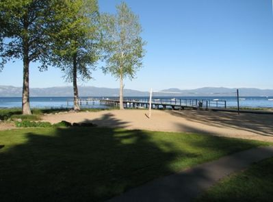 View of sand volleyball court, dock and Lake Tahoe from the living room