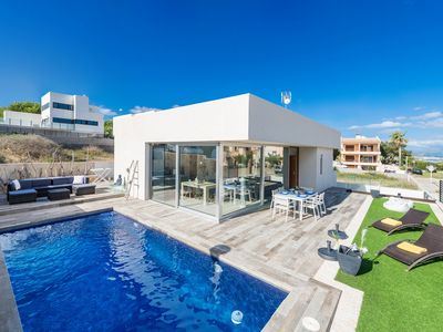 Photo for Modern Holiday Home Directly on the Sea - Casa Es Mollet